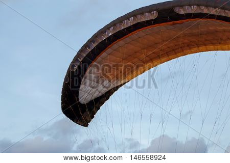 Paramotor on the sky in the evening.