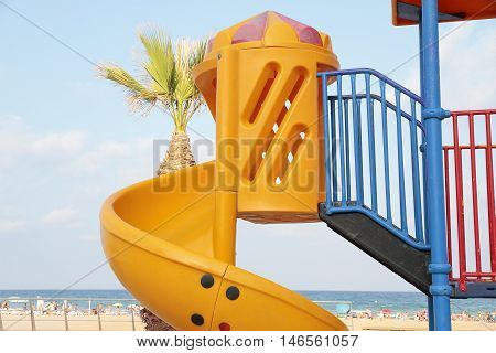 detail of a orange toboggan in a recreation area at the beach