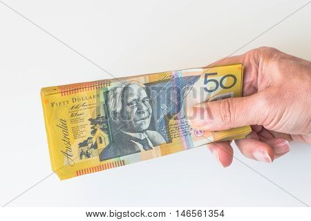 Man Holding Fifty Australian Dollar Banknote In His Hands