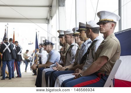 NEW YORK MAY 30 2016: Military personnel from United States Armed Forces seated during the annual Memorial Day Observance service on the Intrepid Sea, Air & Space Museum during Fleet Week NY 2016.