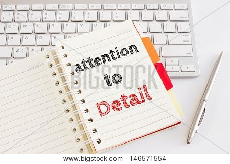 Word text attention to detail on white paper card on office table / business concept