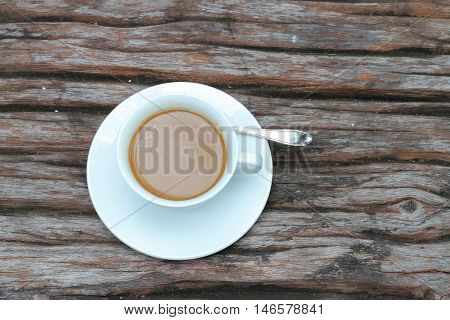 coffee cup put on wood background .