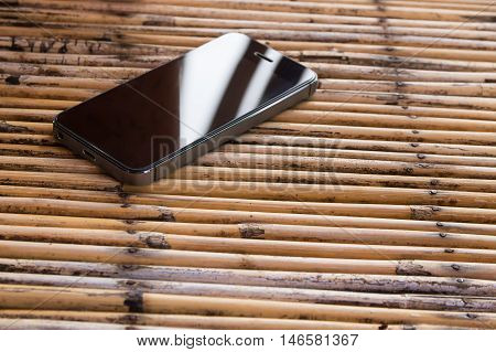 Moblie smart phone on wood table background