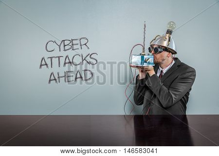 Cyber attacks ahead text with vintage businessman kissing machine