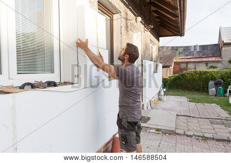 Workers To Renovate A House.