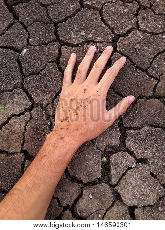 close up hand on crack soil in dry season