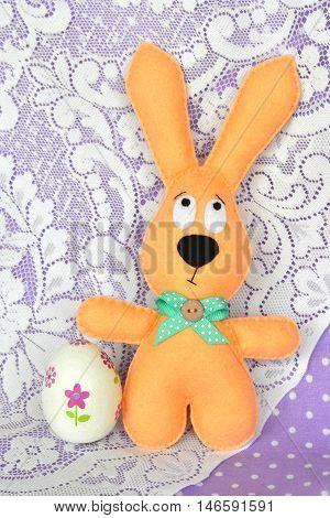 Felt beige rabbit and decoupage egg. Easter symbols. Simple Easter crafts