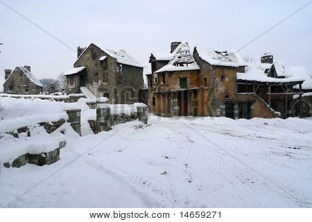 Old deserted village ruins in the middle of the winter poster