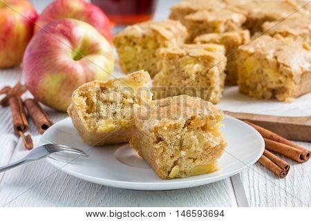 Homemade blondie (blonde) brownies apple cake square slices on plate horizontal