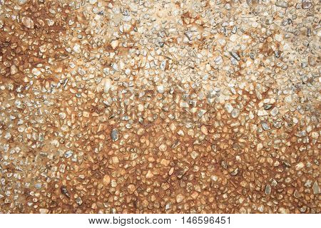 Stone wall decoration texture on modern building facade. Wall round stone rock texture and seamless background