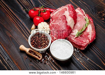 Uncooked organic shin of beef meat on wooden table