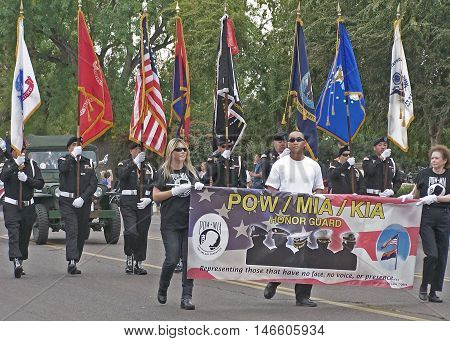 PHOENIX, AZ, USA - NOV. 11: POW/MIA/KIA Honor Guard marching in Veteran's Day Parade in Phoenix, Arizona on November 11, 2011