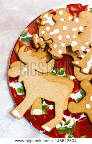 Figure Ginger Christmas Cookies On A Red Plate