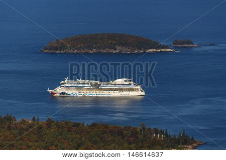 BAR HARBOR, USA - OCTOBER 15, 2015: The cruise ship AIDA Diva with it's characteristic logo of lips and eyes on both sides of the ship in the bay of Bar Harbor (Maine USA)