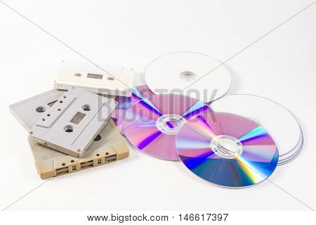 cassette tapes and cds on the white background
