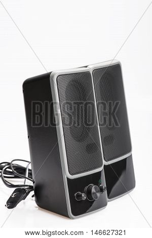 Audio system for mobile phones computer and laptops with amplifier.