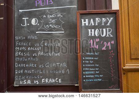 Paris France : August 13 2016 - Menu board outside a french restaurant in the marais district of paris france