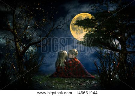 Children whispering in the fairy magic forest. Big moon night little boy and girl. Picture - a fairy tale for children