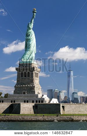 The Statue at New York City with the Freedom Tower