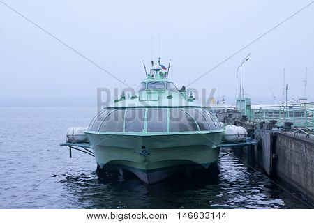 Passenger Hydrofoil Boat On The Docks Of Onego Lake In Foggy Weather, Petrozavodsk, Karelia, Russia.