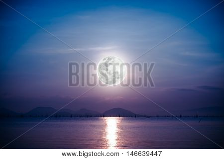 Fantastic view of the sea. Romantic scenic with full moon on sea to night. Reflection of moon in water. Vignette picture style.