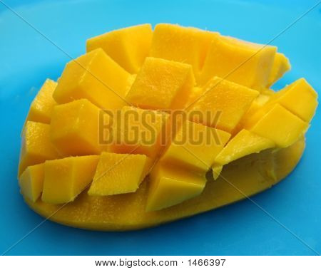 Mango In Cubes On Blue