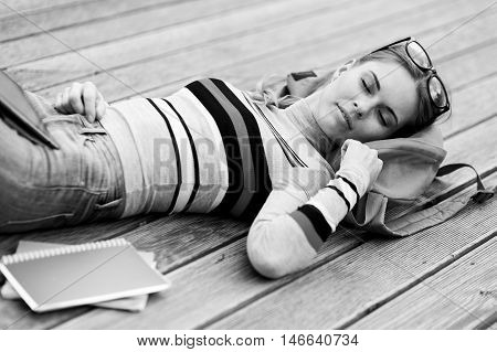 Tired student fell asleep on wooden stage.black and white photo