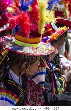 Puno Peru - August 20 2016: Native people from peruvian city dressed in colorful clothing perform traditional dance in a religious celebration. Peru South America.