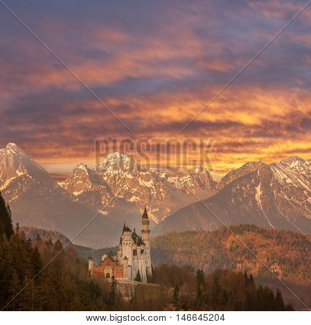 Landscape witn famous Neuschwanstein castle mountains on backdrop and majestic sky Germany
