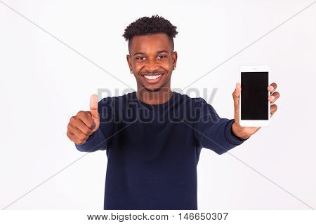 Young African American Man Holding A Smartphonemaking Thumbs Up Gesture - Black Teenager People