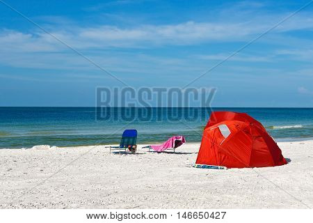 A Red Kids Beach Shelter and Chairs on the Sandy Beach of Anna Maria Island Florida