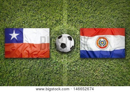 Chile Vs. Paraguay Flags On Soccer Field, 3D Illustration