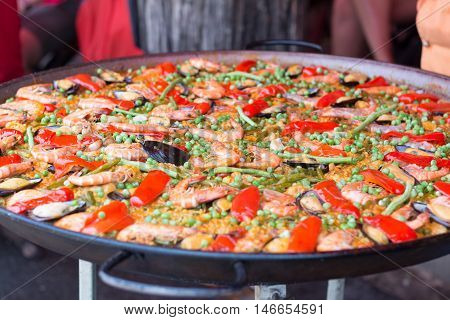 Traditional spanish rice paella with sea food. Mixed seafood stir fried spicy and salad.Traditional seafood paella