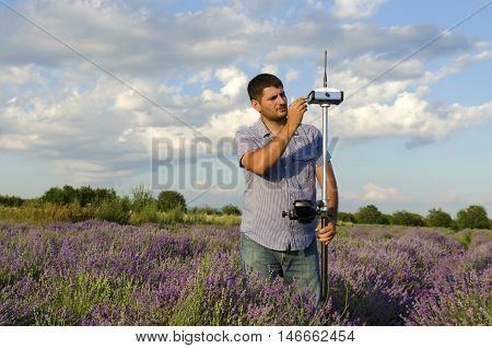Horizontal shot of land surveying work in lavender