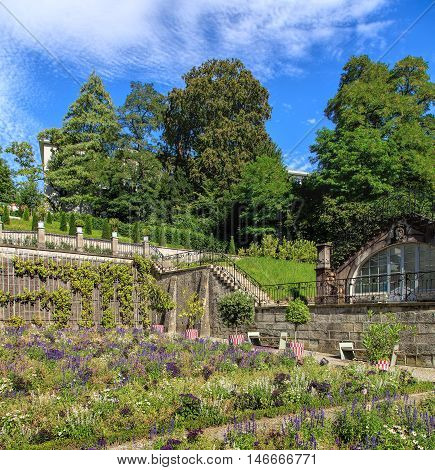 Zurich, Switzerland - 14 August, 2016: view in the Rechberg Garden. The Rechberg Garden is a public park on the compound of the University of Zurich, it serves the general public and the students as a place of recreation.