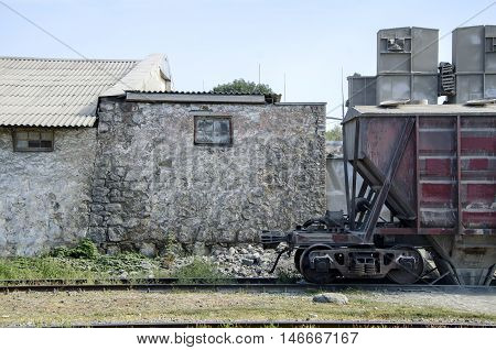 Wagon and old wall. Wagon on old station