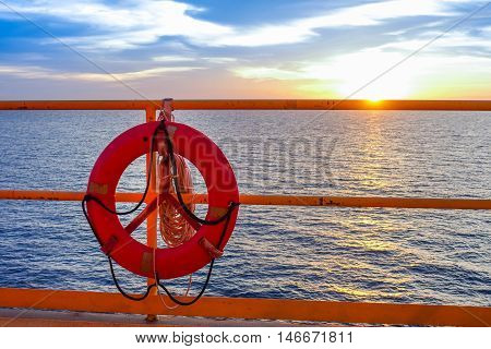 Life buoy hanging on the handrail of offshore platform oil and gas.