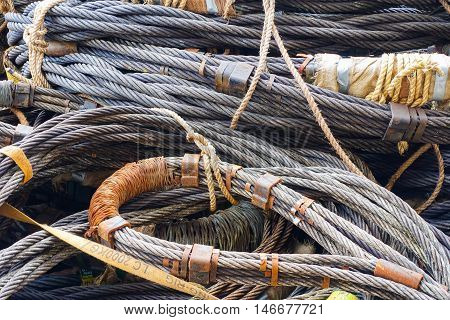 Heavy duty steel wire rope sling in construction site on offshore platform.