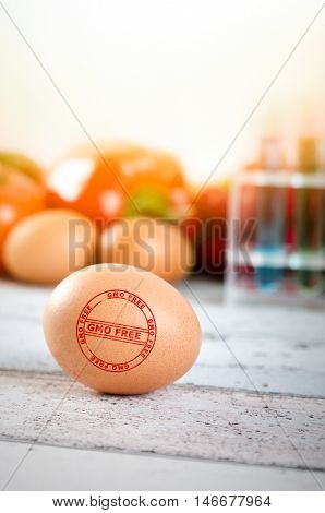 Healthy Eggs With Gmo-free Stamp. Vegetables In Background.