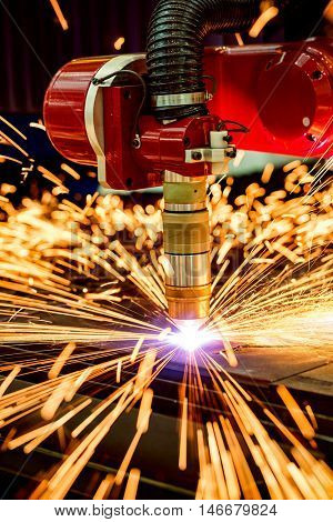 CNC Laser plasma cutting of metal, modern industrial technology. Small depth of field.