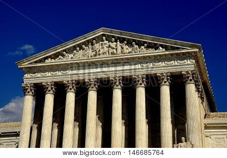 Washington DC - April 9 2014: Neo-classical west front of the 1935 United States Supreme Court on First Street SE with its majestic Corinthian columns and typmanun bas reliefs