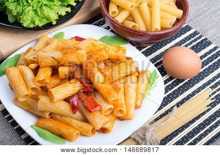 Top View Of A Dish Of Rigatoni Pasta With Vegetable Sauce
