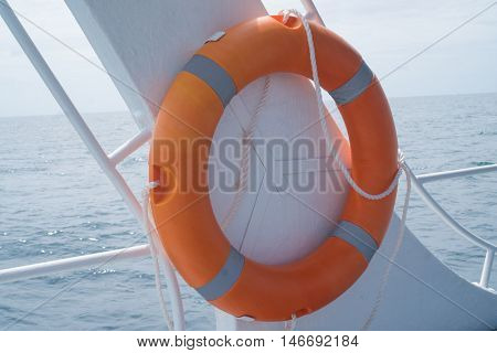 Life buoy attached to the cruise ship over sea and sky