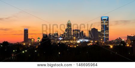 The deep orange colors from the sun fill the skyline of Charlotte, North Carolina at sunrise