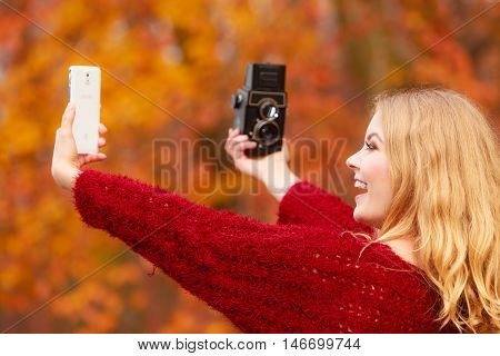 Woman With Camera And Smartphone Take Selfie Photo