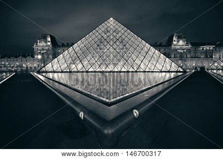 PARIS, FRANCE - MAY 13: Louvre closeup view on May 13, 2015 in Paris. With over 60k sqM of exhibition space, Louvre is the biggest Museum in Paris.