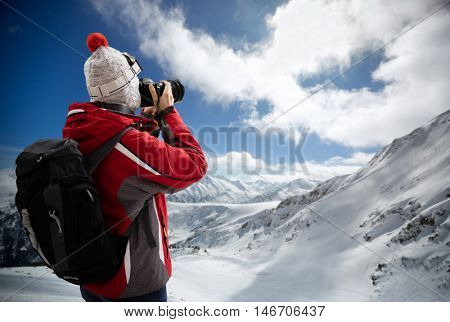 Photographer overlooking winter landscape