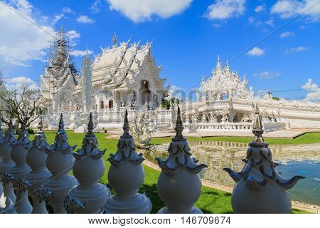 Wat Rong Khun, perhaps better known to foreigners as the White Temple,art exhibit in the style of a Buddhist temple in Chiang Rai Province, Thailand.