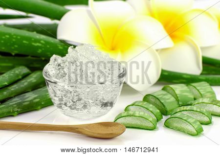 Pure Aloe Vera Gel On Aloe Vera Leaves And Plumeria Background.