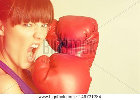 Aggressive beautiful young woman boxing
